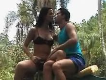 Shemale and guy have fun in natura