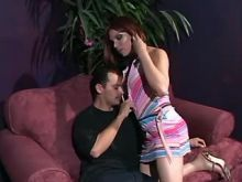 Redhead beauty shemale deep throats cock on sofa