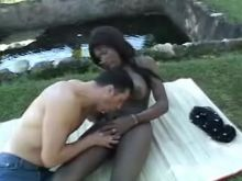 Busty ebony shemale drills white dude outdoor