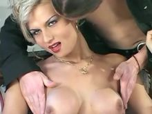 Guy plays with hard cock of gorgeous blond shemale