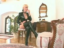 Misterss shemale in high boots spanks poor slave