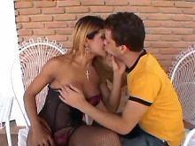 Spoiled guy serves shemale in stockings outdoor