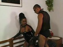 Horny ethnic shemale sucks cock of dude in mask
